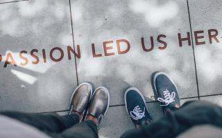 text on pavement: passion led us here